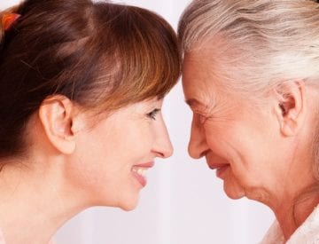A caregiver and an aging loved one enjoy time together